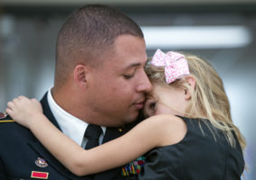 Sergeant Malcolm Massey holds his daughter Madison, 5, on Friday, Oct. 19, 2018, at Roper Elementary School after a surprise homecoming visit to her school.
