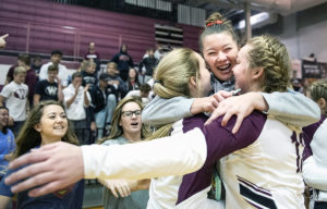 Waverly's Mollie Grosshans (left) and Tryza Hoos are congratulated by classmate Abbie Carter (center) following their B-5 district title win over Beatrice on Saturday, Nov. 3, 2018, at Waverly High School.