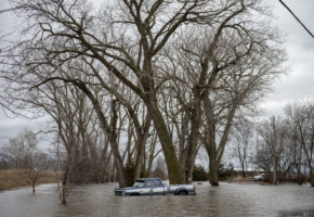 A truck partially submerged truck is surrounded by floodwater from the Platte River near Emerson Estates on Thursday, March 14, 2019, near Inglewood, Nebraska.