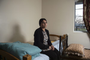 Earlier this year Shireen Ibrahim, who poses for a portrait on her bed Sunday, Nov. 12, 2017, moved to the U.S. and now lives among Lincoln's Yazidi population.  Ibrahim spent more than eight months enslaved by ISIS forces and tells her story to raise awareness about the ongoing plight of her people in Iraq.