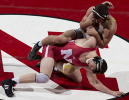 Nebraska's Taylor Venz works on escaping from under Wyoming's Chaz Polson Friday, Nov. 17, 2017, at the Devaney Sports Center. Venz defeated Polson 18 to 2 in the 184 pound weight class.