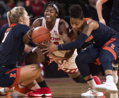 Nebraska's Jasmine Cincore (center) fights over the ball with Illinois players (from left) Courtney Joens and Brandi Beasley during the first half Thursday, Feb. 1, 2018, at Pinnacle Bank Arena.