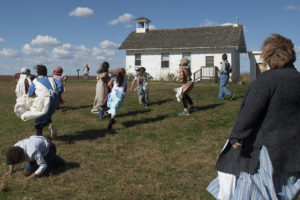 "Children from Megan Simsic's fourth grade class play outside of the one room school house at Pioneers Park Nature Center on Monday, Oct. 23, 2017, during a field trip. Students experience what a day was like in a one-room schoolhouse in 1892.  During this ""role play"", students participate in songs, stories, and other activities that are authentic to the time period."
