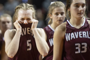 Waverly's Sydni Schernikau (5) and Ellie Bream (33) walk off the court after falling to Northwest in a Class B semifinal on Friday, March 1, 2019, at Pinnacle Bank Arena.