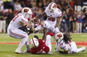 Wisconsin linebacker Ryan Connelly (43) recovers a ball stripped from Nebraska wide receiver Stanley Morgan Jr. (8) by Wisconsin cornerback Derrick Tindal (25) as safety D'Cota Dixon (14) helped on the play in fourth-quarter action at Memorial Stadium on Saturday, Oct. 7, 2017.