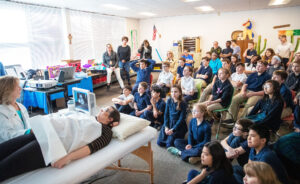 Students watch as Kathy Havranek conducts an ultrasound on Kelly Miller during a presentation by Heart of a Child Ministries on Friday, February 28, 2020, at St. Mary's School in Omaha.