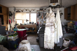 A wedding dress belonging to Jana Post, hangs to dry in the family's garage on Wednesday, March 27, 2019. The wedding dress had been stored in the basement, and although water did not reach the first floor of the house, much of the basement took on water.