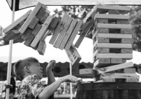 Gabe, 9, winces as the Jenga blocks fall after he removed a block from the lower half of the tower, at the Roots N Blues festival in Columbia, Mo., Sunday, Oct. 2, 2016. Gabe had been playing for over 30 minutes with his cousin before the tower came crashing down.