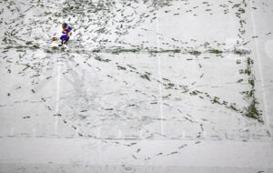 Bellevue West's Richard Carper creates a triangle in the snow tin his footprints as he practices kicks before taking on Westside during the Class A state championship game on Tuesday, Nov. 26, 2019, in Lincoln.