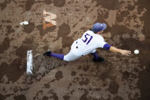 Washington's Alex Hardy warms up in the bullpen after over four hours of rain delay in the top of the sixth inning during game five of the College Word Series against Oregon State on Monday, June 18, 2018, at TD Ameritrade Park in Omaha.