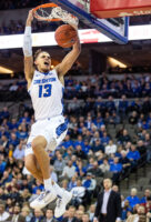 Creighton's Christian Bishop dunks against Oral Roberts on Tuesday, Dec. 3, 2019, at CHI Health Center.
