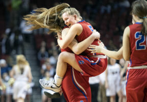 Crete's Jayda Weyand (5) jumps into Andrea Miller's arms after winning over Elkhorn South in a Class B semifinal on Friday, March 1, 2019, at Pinnacle Bank Arena.