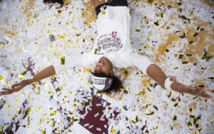 Stanford's Courtney Bowen makes a confetti angel following the team's win over Nebraska in the NCAA championship on Saturday, Dec. 15, 2018, at the Target Center in Minneapolis.
