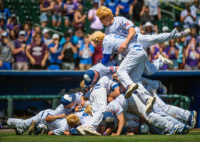 Bennington's Tyler LeClair (15) and Cooper Prososki (6) jump on top of the dog pile celebrating their Class B baseball title over Hastings on Thursday, May 16, 2019, at Werner Park in Omaha.