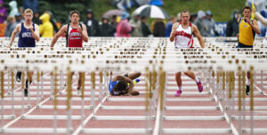 Boys Town's Tijah Davis falls to the ground after being tripped up by a hurdle during the Nebraska State Track Meet on Saturday, May 19, 2018, at Omaha Burke Stadium.