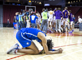 Millard North's Hunter Sallis collapses to the court as Bellevue West celebrates their win over Millard North during the Class A Nebraska State Basketball Championship on Saturday, March 14, 2020, at Pinnacle Bank Arena in Lincoln.