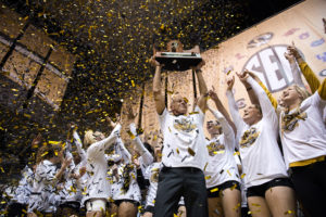 Mizzou Volleyball Head Coach Wayne Kreklow hoists the  SEC Championship trophy into the air after the team defeated Tennessee in three straight sets at the Hearnes Center on Saturday, Nov. 26, 2016.  The Tigers ended the season with a 16-2 conference record and automatically moved onto the NCAA tournament.