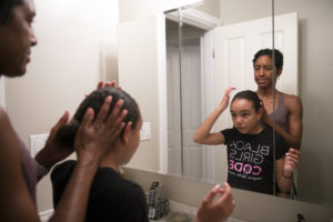 Shawn Brokemond combs Nikiah's hair and ties it back in a loose bun Monday, June 4, 2018, before putting Nikiah to bed at their home in Mill Valley.