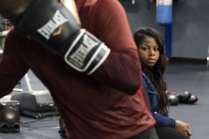 OMAHA, NEBRASKA – MAY 21:   Alindra Person, the mother of Terence Crawford's children, watches as Crawford finishes his last round of bag work at B&B Boxing Academy on Monday, May 21, 2018. (Kayla Wolf for ESPN)