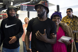 OMAHA, NEBRASKA – MAY 21:  Terence Crawford, center, walks his grandma Aloma Bowman to her seat at his nephew's graduation from Bryan High School at Baxter Arena on Monday, May 21, 2018. (Kayla Wolf for ESPN)