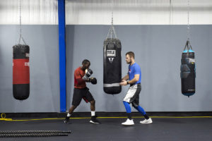 OMAHA, NEBRASKA – MAY 21:  Terence Crawford, left, goes through timed rounds of working the bag and box jumping with Wayne Sullivan, right, a friend of Crawford's who competes in the Mixed Martial Arts scene, at B&B Boxing Academy on Monday, May 21, 2018. (Kayla Wolf for ESPN)