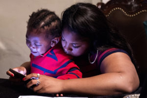 OMAHA, NEBRASKA – MAY 21: Alindra Person, right, comforts her son Tacari Crawford during a large family gathering at Debra Crawford's house Monday, May 21, 2018. (Kayla Wolf for ESPN)