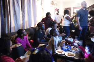 OMAHA, NEBRASKA – MAY 21:  Family members gather around the TV to watch Terence Crawford, center, play NBA 2K18 with his nephew Tre'vion Crawford, center right, during a family gathering at Terence Crawford's childhood home on Larimore Street on Monday, May 21, 2018. (Kayla Wolf for ESPN)