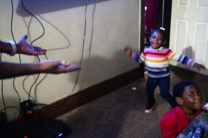 OMAHA, NEBRASKA – MAY 21:  Talaya Crawford dances around the living room during a family gathering at Terence Crawford's childhood home on Larimore Street on Monday, May 21, 2018. (Kayla Wolf for ESPN)