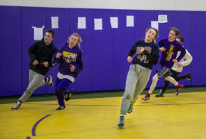 """Jerzie Menke runs sprints with her team as they prepare for Class C-4 districts. The team's goal was to place in the top two in their district and Menke's personal goal was to wrestle hard. """"I've been watching film to prepare,"""" Menke said."""