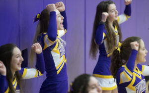 """Menke tried out for her school's cheerleading squad on a dare. When Menke was younger fliers advertising Federation wrestling and cheerleading arrived in the mail. """"I was like, 'I'm not going to cheer.' Well, now, I've cheered all four years of high school,"""" she said."""