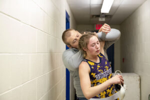 Bridgeport wrestling coach Zach Malcolm demonstrates to Jerzie Menke how she should escape a hold following her loss. While Menke's senior season came to an end, her wrestling career continues, first with club competition and then on to the collegiate level.