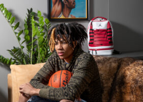 Hunter Sallis, Nebraska's first 5-star recruit in basketball, sits for a portrait Wednesday, March 4, 2020, in downtown Omaha.