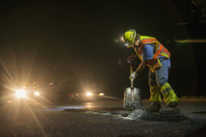 MoDot Project Supervisor Steve Galen fills a pothole along I-70 during the night shift on Tuesday, May 24, 2016. Due to a Columbia has an ordinance stating that roadwork on  I-70 can only be conducted at night.