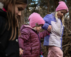 Hikers, from left, Olivia Clark, Shelby Huenink and Sophie Huenink walk through the woods with their parents, not pictured, Wednesday, Jan. 1, 2020, during the First Day Hike at Mahoney State Park.