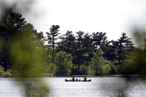 A family canoes across Holmes Lake on Wednesday, June 26, 2019, during a Lincoln Parks and Recreation Play in the Parks free canoeing event.