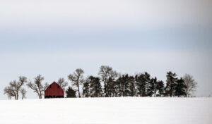 A barn sits atop a snow covered hill near Weeping Water on Thursday, Feb. 21, 2019.
